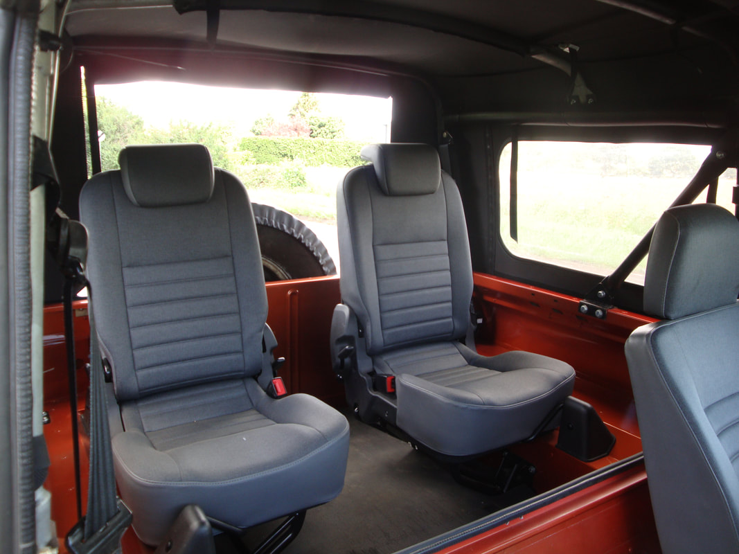 defender puma seat conversion
